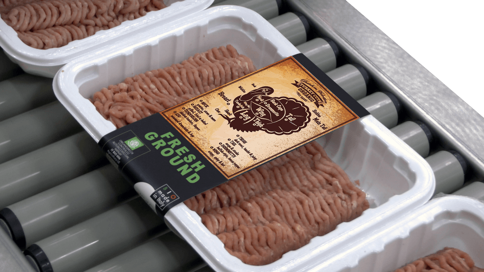 Labeling Meat Trays with Banding